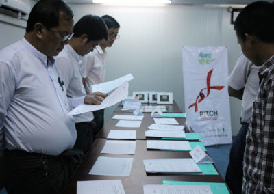 Letters being presented to the Communities and Civil Society Representatives for signatures